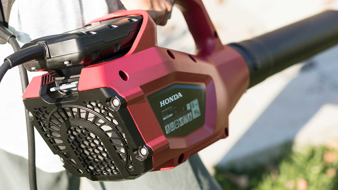 Close up view of Honda leaf blower with battery attached.