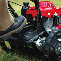 Close up of Grass Cutter foot pedal.