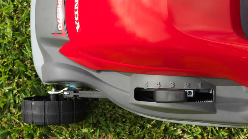 Honda HRE lawnmower, close up of deck height adjustment handle.
