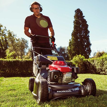 photo of man mowing lawn with honda hrh 536 petrol lawnmower