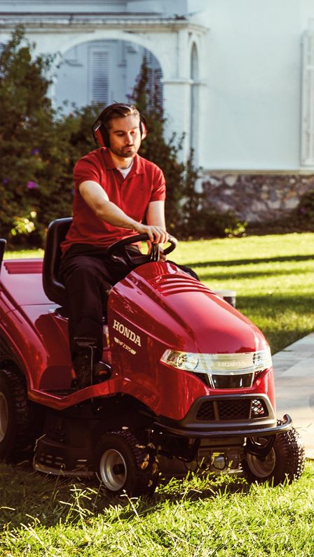 Model mowing the lawn with a Lawn Tractor