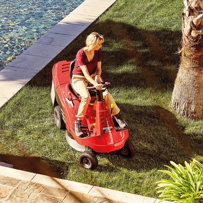 Ride-on, front three-quarter, left facing, being used by model, garden location.