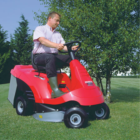 Ride-on, front three-quarter, right facing, being used by model, garden location.