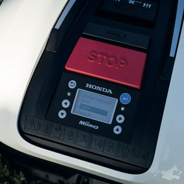 Close up of Honda Miimo display and stop button.