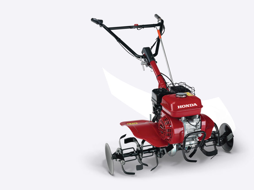 Front three-quarter, right facing Compact tiller.
