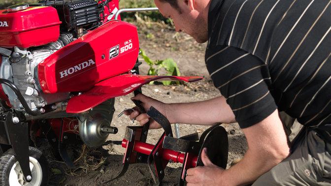 Model adding new attachment to Compact tiller, garden location.