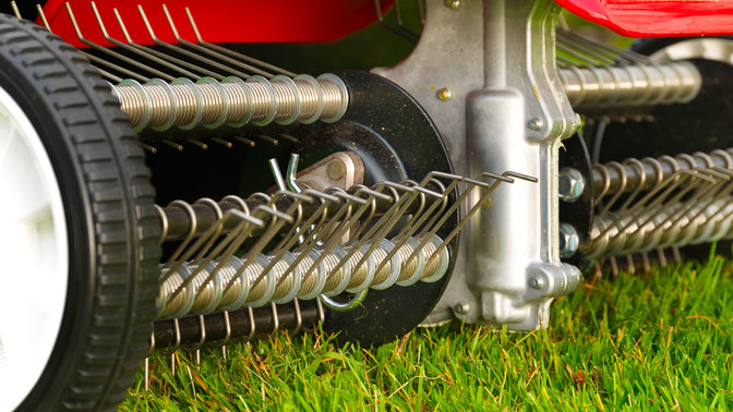 Close up of scarifier, garden location.