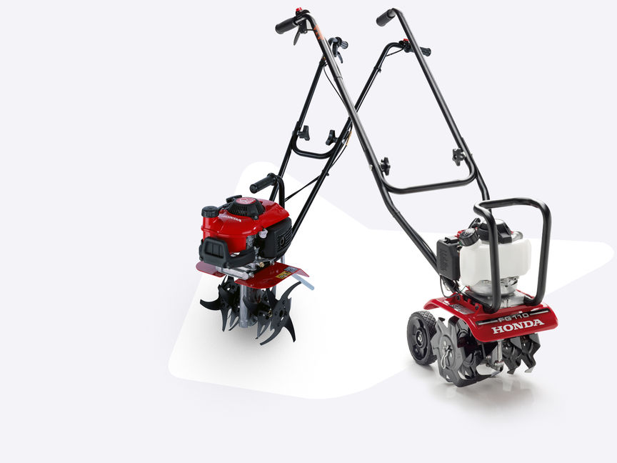 2x Honda Microtillers with different attachments.