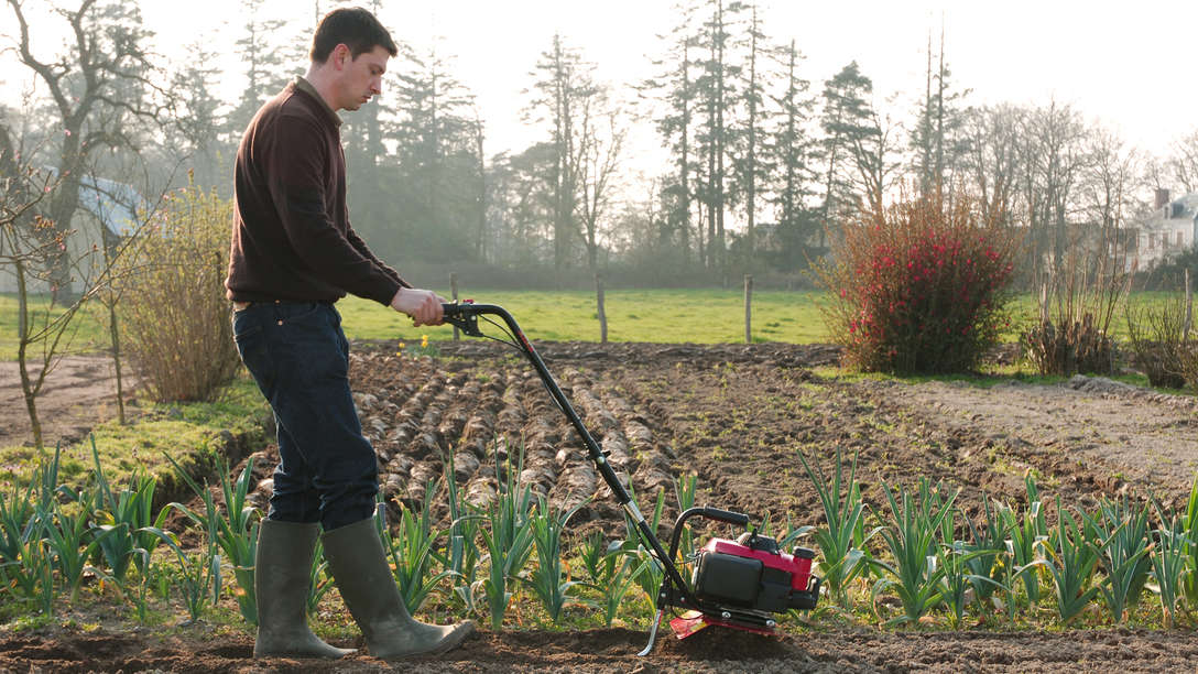 Honda Microtillers, being used by model, on location.