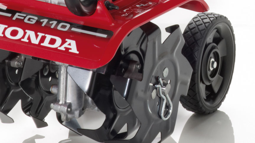 Honda microtillers, close up, focusing on wheels.