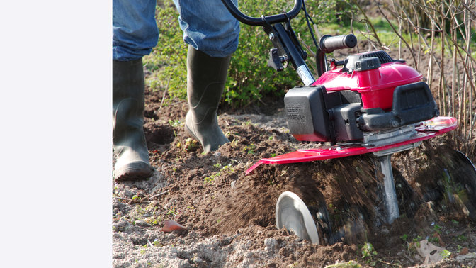 Mini tiller, in use, garden location.