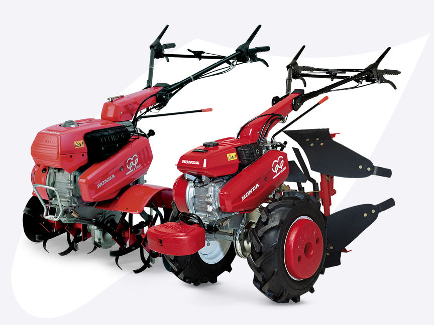 2x Honda Versatile Tillers, front-three quarter, left facing.