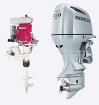 Two Honda Marine engines on white background