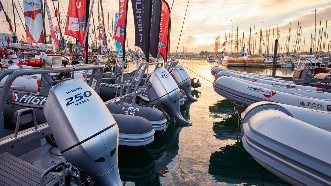 A row of boats in the harbour with Honda BF250 engines.