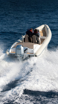 Boat using BF250 engine, being used by models, coastal location.