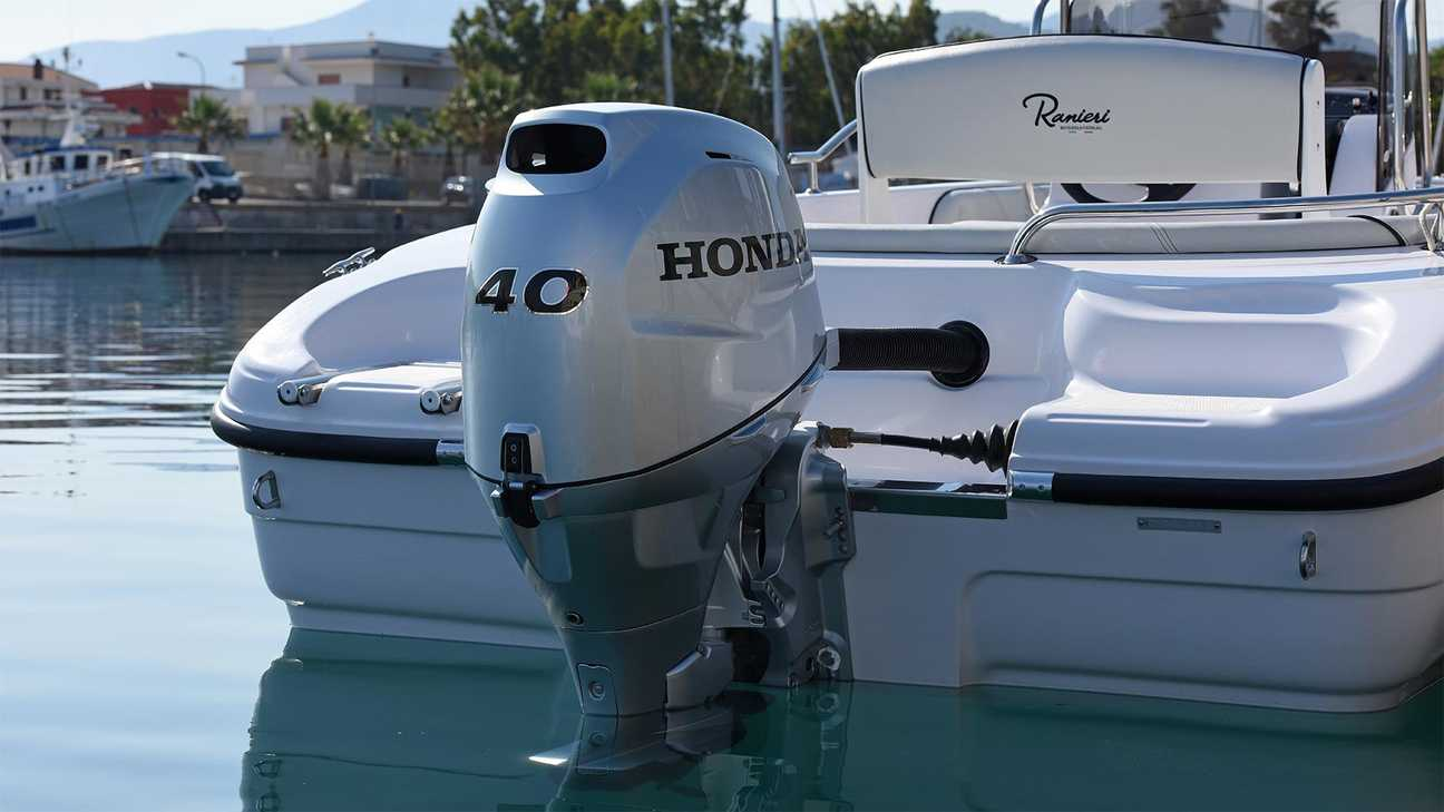 A moored luxury speed boat with a Honda BF 40 outboard engine