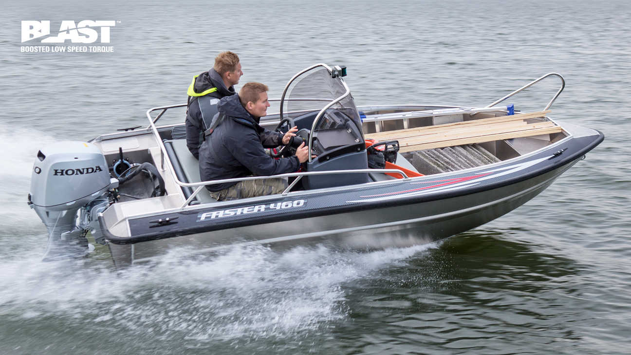 side view of two men steering a boat powered by a honda marine engine
