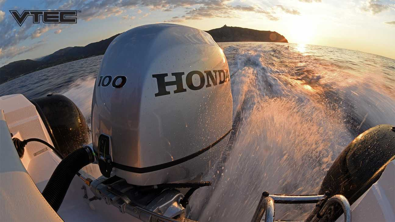 Rear facing sunset view of a moving speed boat looking onto a Honda BF 100 outboard engine