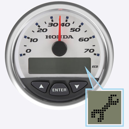 Close up of rev counter, focusing on wrench symbol.