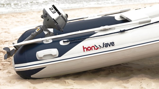 Side view of Honda inflatable, beach location.