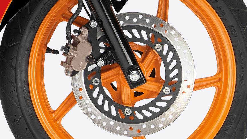 Close-up of front wheel, focusing on disc brake.