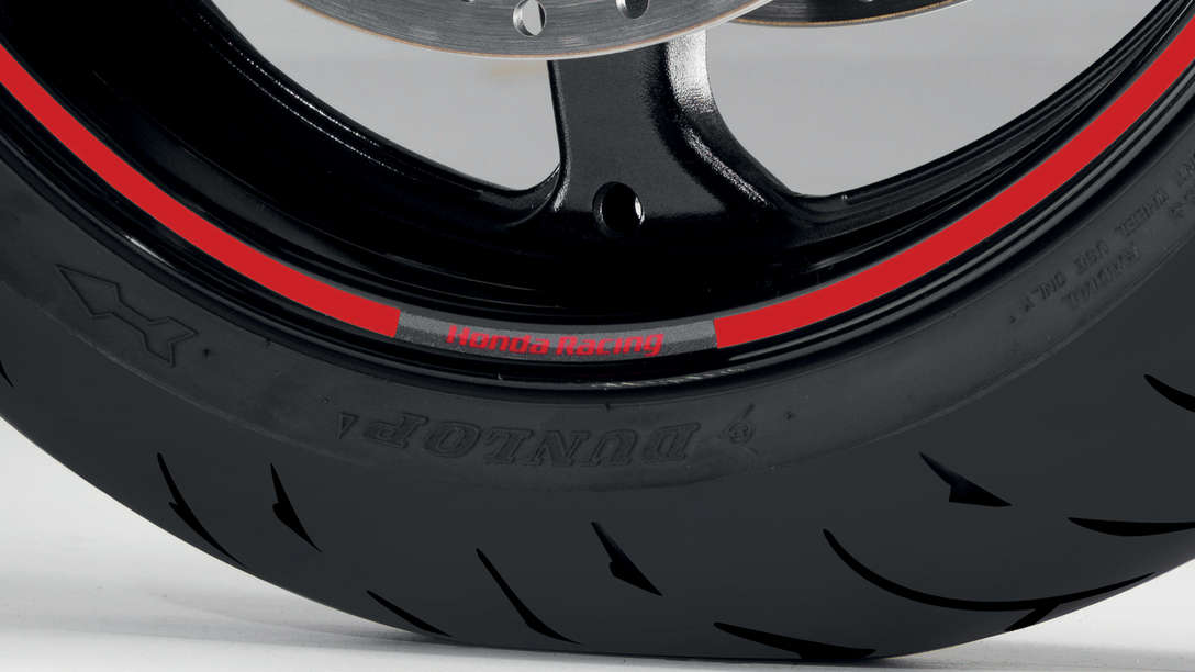 Extreme close-up of wheel rim, focusing on rim sticker.