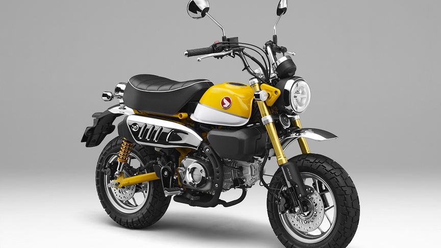Monkey 125cc, 3-quarter front right side, grey background