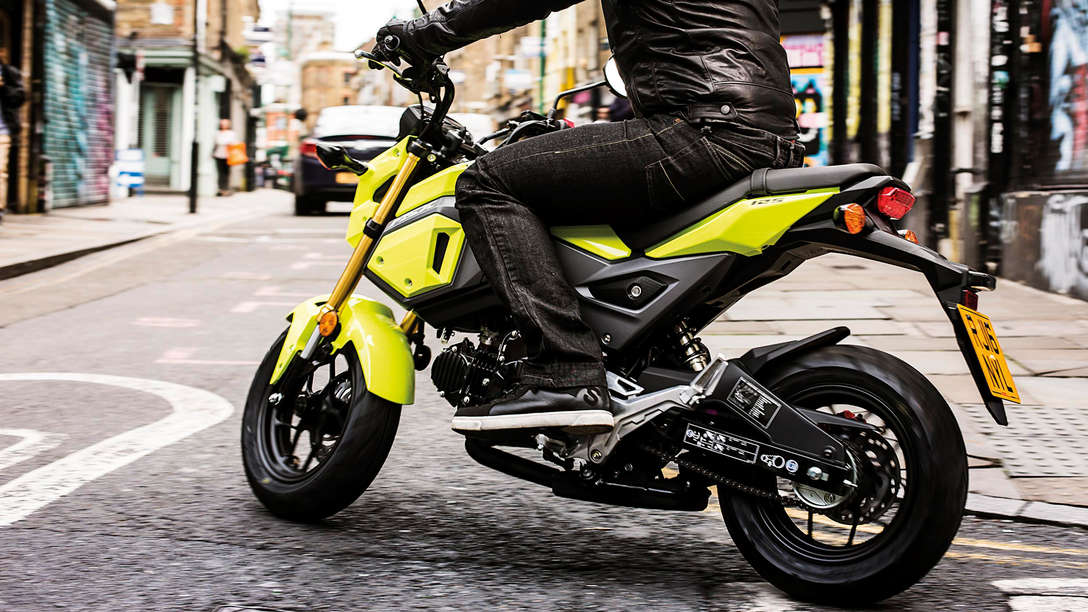 Honda MSX125 being ridden on street