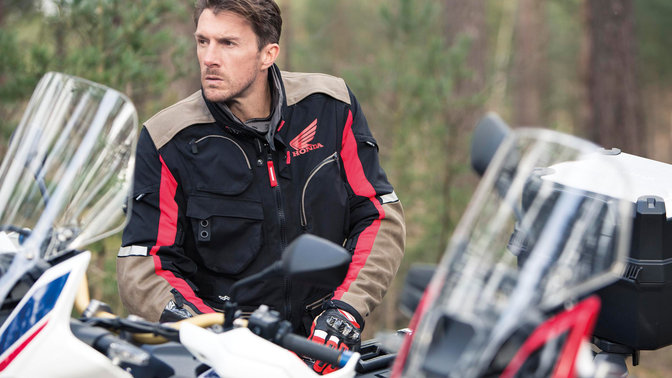 Close-up of man wearing black Honda Spidi Adventure Jacket