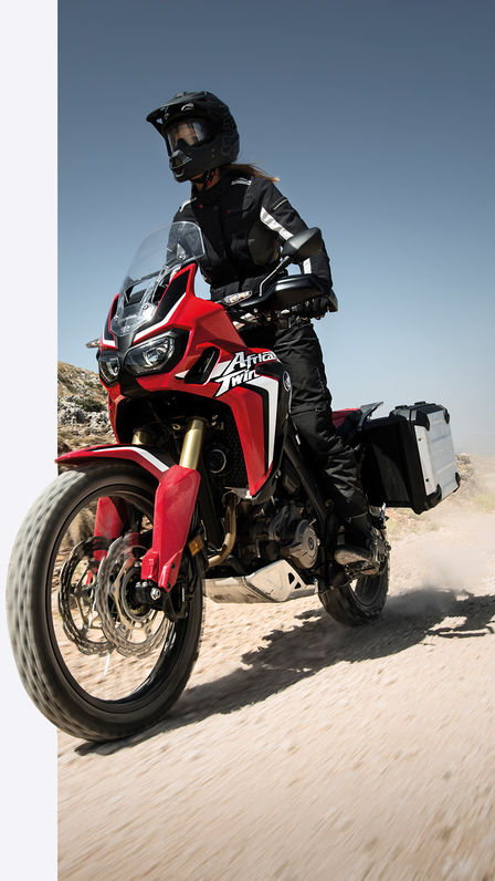 Africa Twin riding on dusty ground