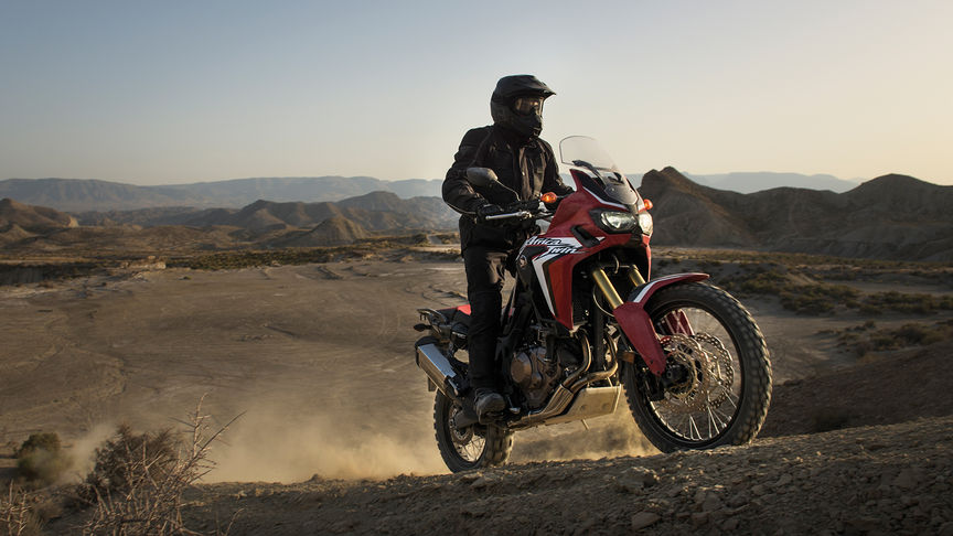 rider climbing up hill on Africa Twin