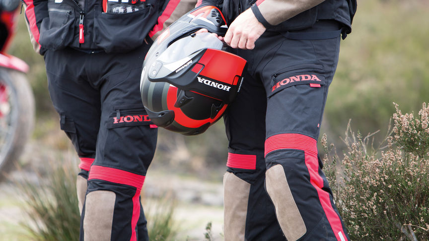 Two men wearing Honda motorcycle trousers