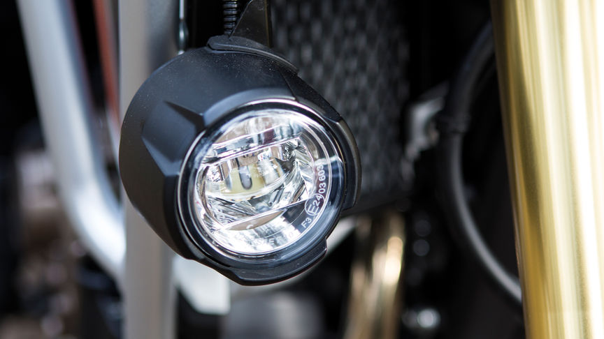 A close up of a fog light on the Africa Twin