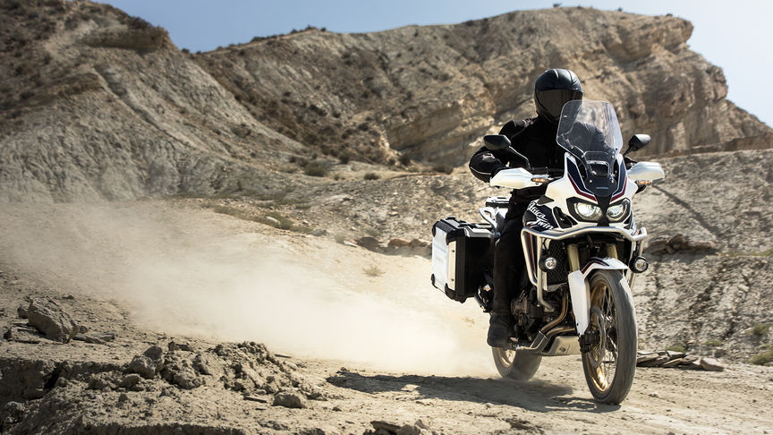 An Africa Twin motorcylce riding through the desert