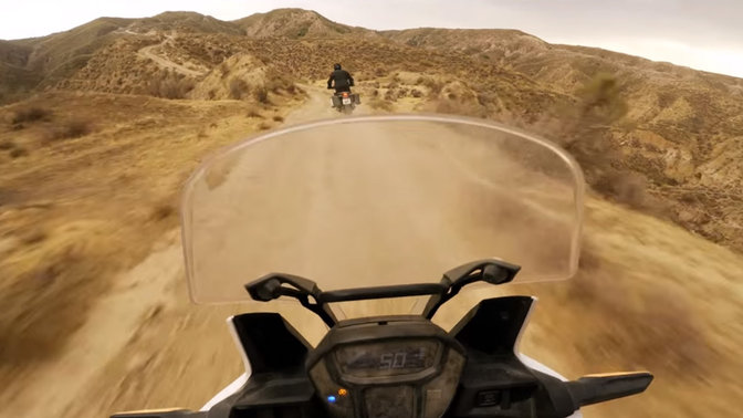 Rider's view on an Africa Twin riding through the desert