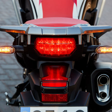 Close up of Honda Africa Twin brake lights.