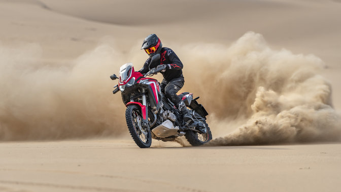 Honda Africa Twin, 3-quarter front left side, riding in sand