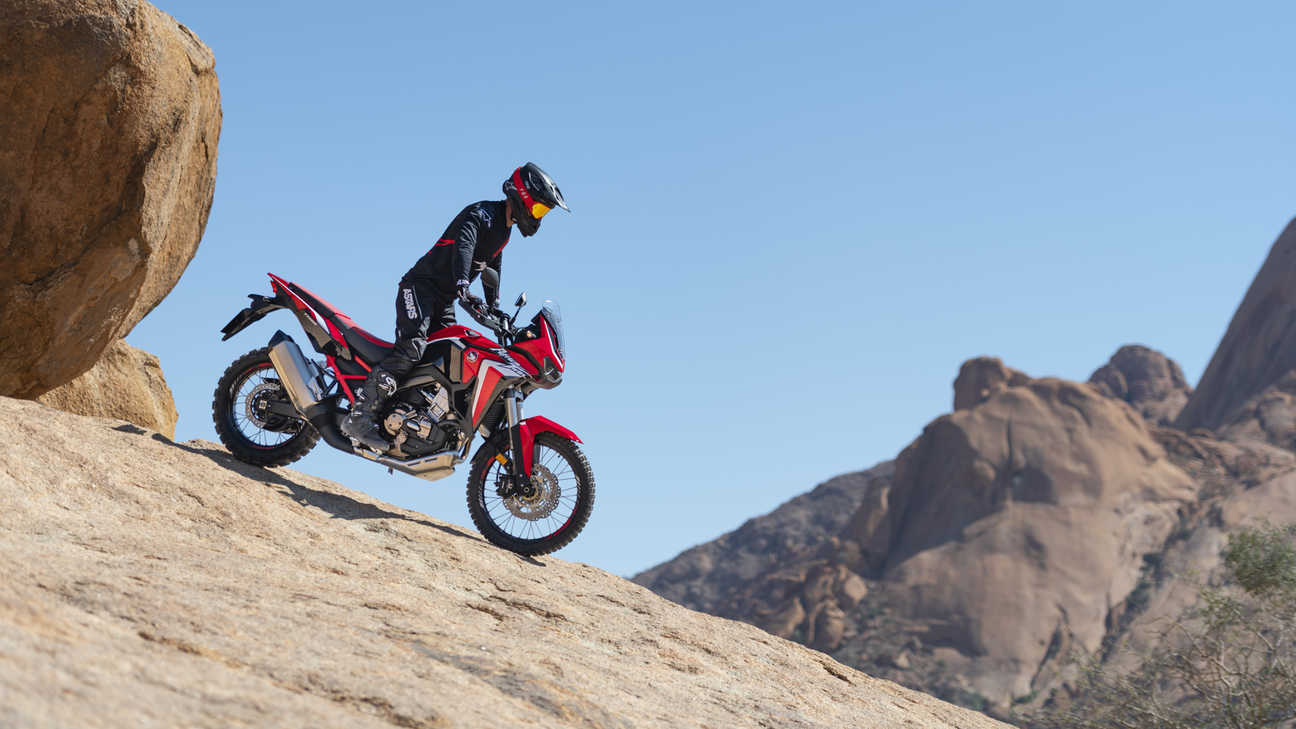 Honda Africa Twin, right side, riding down a rock