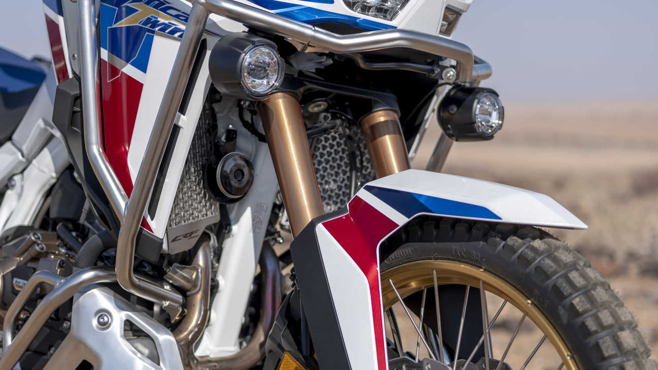 Honda Africa Twin Adventure Sports, front shot, headlights on, in desert landscape