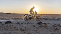 Honda Africa Twin Adventure Sports, right side, riding on a dirt road through a desert landscape