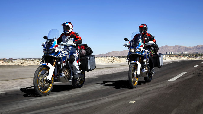 Two riders on Honda Africa Twin Adventure Sports on the road.