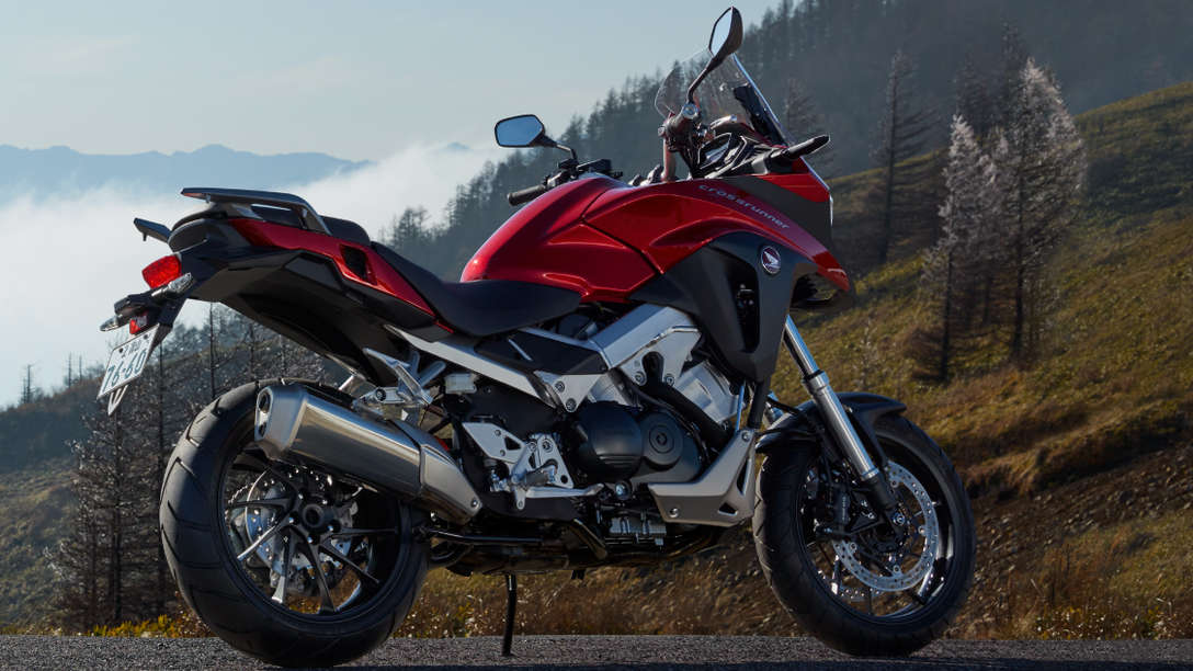 VFR800X parked on mountain road, facing right side