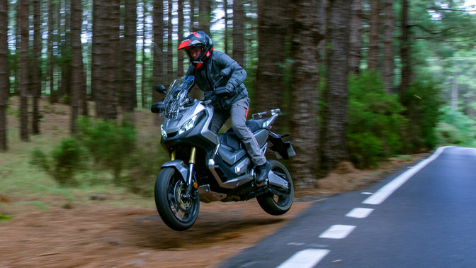 Front three-quarter facing Honda X-ADV action shot.