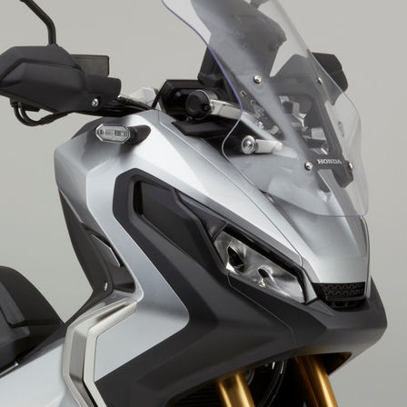 Close up of Honda X-ADV head lights.