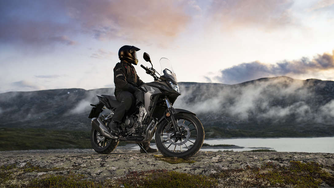 CB500X, right side, parked in mountain landscape with rider.
