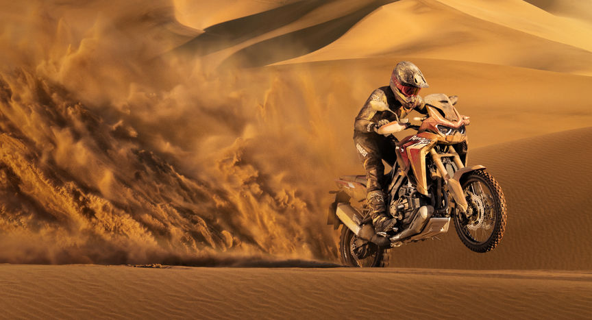 Honda Africa Twin, 3-quarter front right side, riding in sand