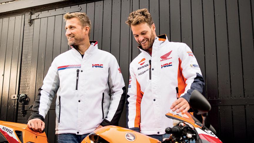 c2ec3da4813 Two men similing wearing white Honda race jackets