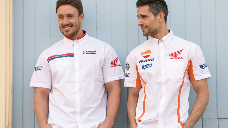 Two men smiling wearing white Honda shirts