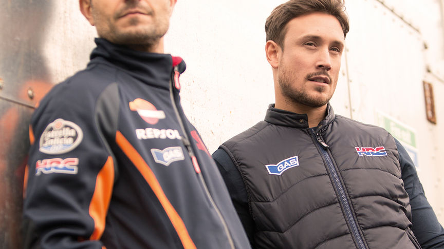 two men wearing dark Honda race jackets