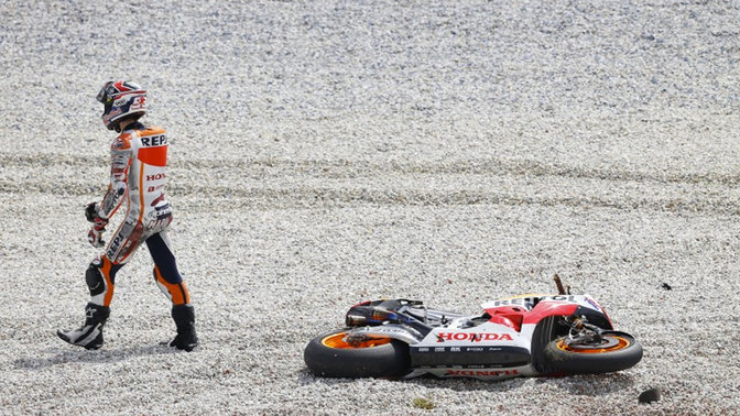 MotoGP racer falling off the motorcycle.
